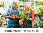 gardeners smiling while holding ... | Shutterstock . vector #454816840