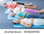 instructor performing yoga with ... | Shutterstock . vector #454830940