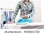 closeup of woman ironing... | Shutterstock . vector #454831720