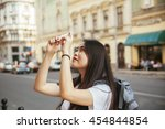 young asian tourists taking a... | Shutterstock . vector #454844854