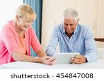 senior couple using a tablet in ... | Shutterstock . vector #454847008