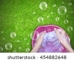 female hand washing clothes in... | Shutterstock . vector #454882648