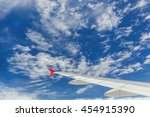 Small photo of airfoil, airplane wink, cloud and sky view from the window on the airplane in sky, airplane, wink, airfoil, sky