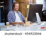 businessman smiling while using ... | Shutterstock . vector #454923046