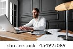 man working at the office next... | Shutterstock . vector #454925089