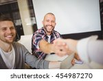 smiling business people shaking ... | Shutterstock . vector #454987270