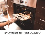 woman put batter for cupcakes... | Shutterstock . vector #455002390