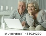 happy senior couple with laptop | Shutterstock . vector #455024230