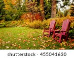 two chairs in the fall leaves... | Shutterstock . vector #455041630