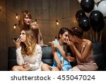 four beautiful girls resting at ... | Shutterstock . vector #455047024