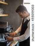 waiter using coffee machine in...   Shutterstock . vector #455059303