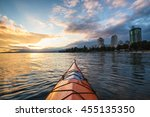 Stock photo kayaking near english bay in downtown vancouver bc canada during a beautiful cloudy sunset with 455135350