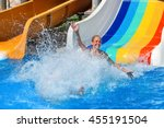 Happy Kid On Water Slide At...