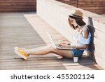 young trendy girl using laptop... | Shutterstock . vector #455202124