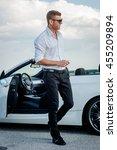 handsome man near the car....   Shutterstock . vector #455209894