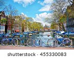 bicycles parked on a bridge in... | Shutterstock . vector #455330083