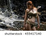 female hunter with a quiver in... | Shutterstock . vector #455417140
