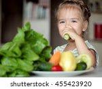 happy little girl eating... | Shutterstock . vector #455423920