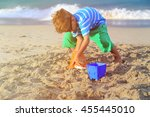 little boy play with sand on... | Shutterstock . vector #455445010