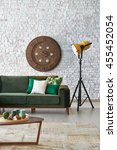 green sofa stone wall with... | Shutterstock . vector #455452054