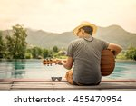 romantic young man sitting on... | Shutterstock . vector #455470954