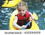 A Kid Kayaking In Beautiful...