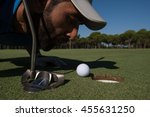 Golf Player Blowing Ball In...