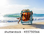 young woman in hat sitting on... | Shutterstock . vector #455750566