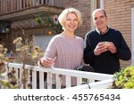 Retired Couple Outside Their...
