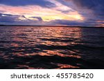 sunset with clouds at the lake | Shutterstock . vector #455785420