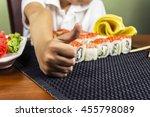 boy eating sushi   Shutterstock . vector #455798089