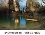 Small photo of Long exposure of tranquil scene inside of Phong Nha Cave with kayak boat in Phong Nha-Ke Bang National Park, a UNESCO World Heritage Site in Quang Binh Province, Vietnam