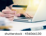 hand holding credit card with... | Shutterstock . vector #456066130