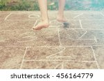 Child Playing Hopscotch On...