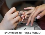 nails saloon woman applying... | Shutterstock . vector #456170830