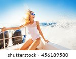 happy overjoyed woman on a boat | Shutterstock . vector #456189580