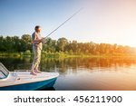 mature man on a motor boat.... | Shutterstock . vector #456211900