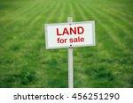 Land For Sale Sign Against...