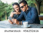 young couple at cafe looking at ... | Shutterstock . vector #456252616