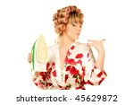 housewife in haircurlers and iron in hand - stock photo