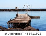 Small photo of Hurricane aftermath: broken dock
