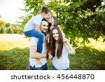 parents sitting with children... | Shutterstock . vector #456448870
