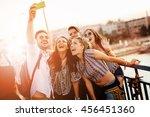 cheerful friends taking selfies ... | Shutterstock . vector #456451360