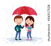 young couple holding umbrella.... | Shutterstock .eps vector #456517528