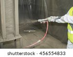 Small photo of Covering a surface by refractory composition.