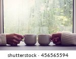 two white cups in hands on a... | Shutterstock . vector #456565594