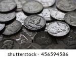 Antique American silver Benjamin Franklin half dollars. - stock photo