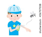 a boy uses bug spray to protect ... | Shutterstock .eps vector #456707038