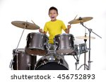 Happy Young Boy Playing Drums