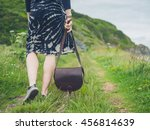 a young woman with a handbag is ...   Shutterstock . vector #456814639